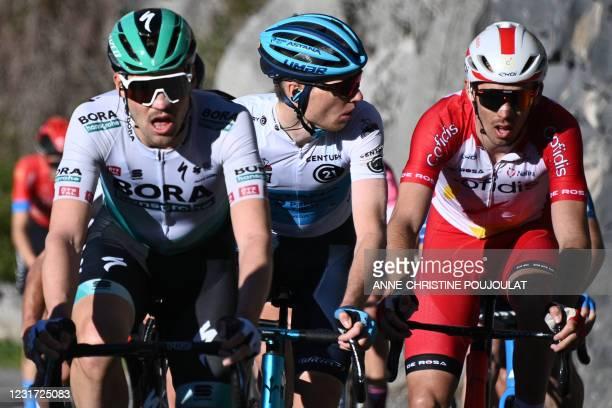 Team Bora rider Germany's Maximilian Schachmann, Team Astana rider Russia's Aleksander Vlasov and Team Cofidis rider France's Christophe Laporte...