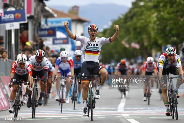 Team Bora rider Germany's Pascal Ackermann celebrates as he finishes first the second stage of the 2019 Giro d'Italia, the cycling Tour of Italy, on...