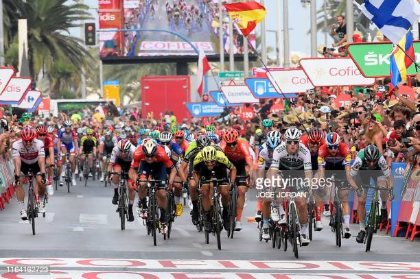 Team Bora rider Ireland's Sam Bennett crosses the finish line and wins the third stage of the 2019 La Vuelta cycling tour of Spain, a 188 km race...
