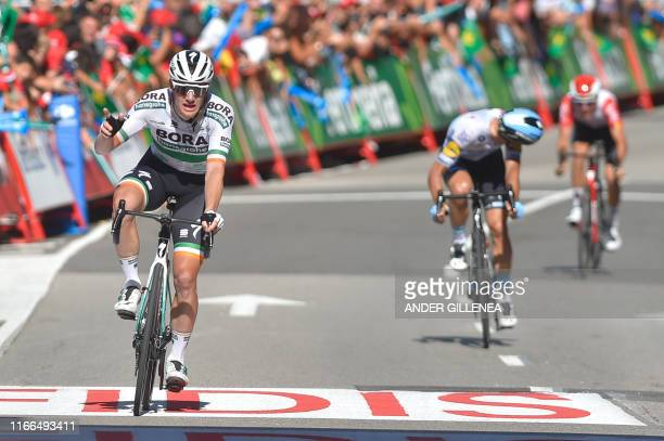 Team Bora rider Ireland's Sam Bennett crosses the finish line of the 14th stage of the 2019 La Vuelta cycling Tour of Spain, a 188 km race from San...