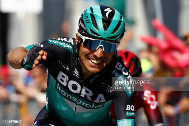 Team Bora rider Italy's Cesare Benedetti reacts as he crosses the finish line to win stage twelve of the 102nd Giro d'Italia - Tour of Italy - cycle...