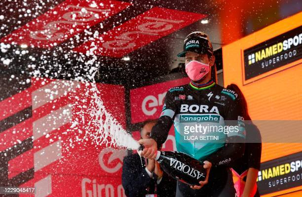 Team Bora rider Slovakia's Peter Sagan celebrates on podium after wins the 10th stage of the Giro d'Italia 2020 cycling race, a 177-kilometer route...