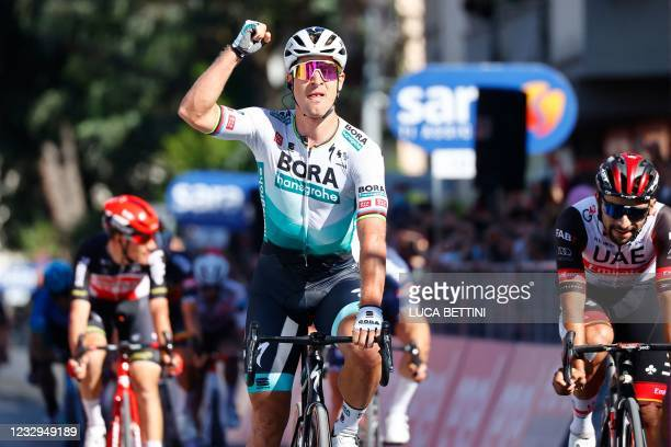Team Bora-Hansgrohe rider Slovakia's Peter Sagan celebrates as he crosses the finish line to win the tenth stage of the Giro d'Italia 2021 cycling...