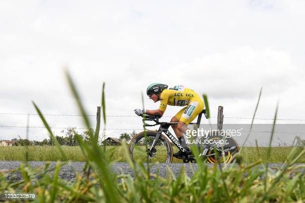 Team Bora's Lukas Postlberger of Austria, wearing the overall leader's yellow jersey competes during the fourth stage of the 73rd edition of the...