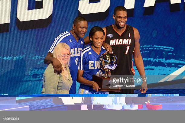 Team Bosh poses with the trophy after winning the Sears Shooting Stars Competition on State Farm AllStar Saturday Night as part of the 2014 AllStar...