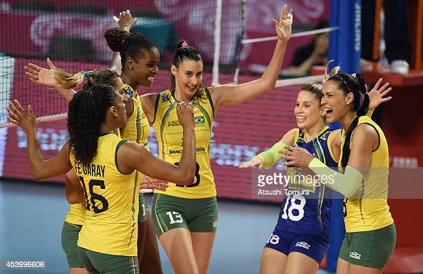 Team Brazil celebrate after winning a point during the FIVB World Grand Prix Final group one match between Russia and Brazil on August 23 2014 in...