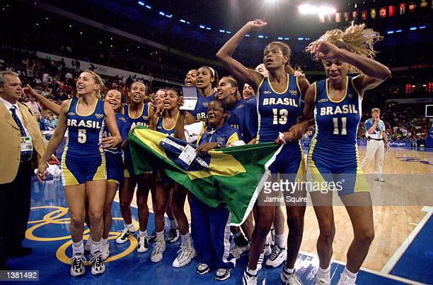 Team Brazil celebrates capturing the bronze after the women's basketball medal game against Korea at the Sydney SuperDome during the Sydney Olympic...