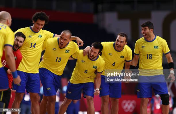 Team Brazil cheer after their national anthem ahead of the Men's Preliminary Round Group A handball match between Argentina and Brazil on day seven...
