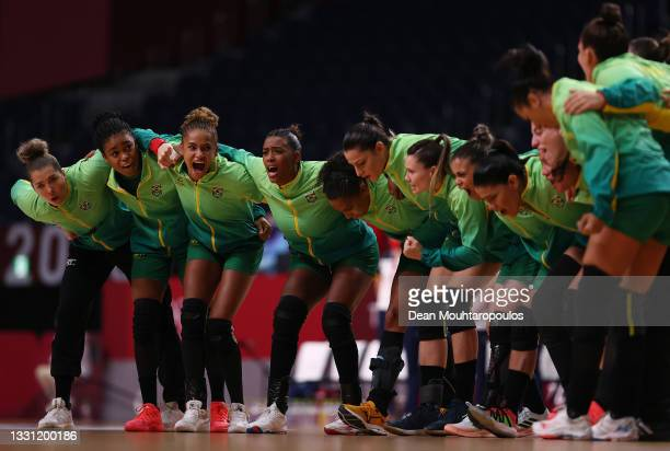 Team Brazil cheer after their national anthem ahead of the Women's Preliminary Round Group B handball match between Spain and Brazil on day six of...