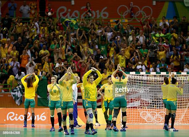 Team Brazil salutes the fans after the win over Montenegro on Day 9 of the Rio 2016 Olympic Games at the Future Arena on August 14, 2016 in Rio de...