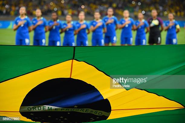 Team Brazil stands at attention during pregame ceremonies before playing against Australia during the Women's Football Quarterfinal match at Mineirao...