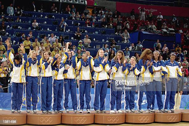 Team Brazil stands for the medal ceremony after capturing the bronze in the women's basketball game against Korea at the Sydney SuperDome during the...
