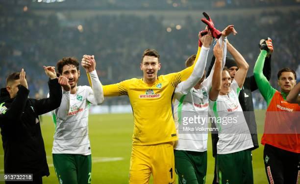 Team Bremen with Goalkeeper Jiri Pavlenka of Bremen celebrate the victory 21 after the Bundesliga match between FC Schalke 04 and SV Werder Bremen at...