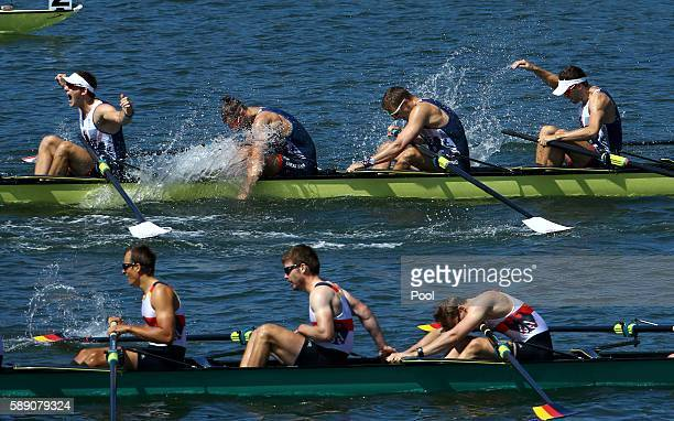 Team Britain members celebrate their gold medal finish as Team Germany react to their silver medal finiah in the Men's Eight Final A at Lagoa Stadium...