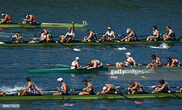 Team Britain members celebrate their gold medal finish in the Men's Eight Final A at Lagoa Stadium August 13 2016 in Rio De Janeiro Brazil