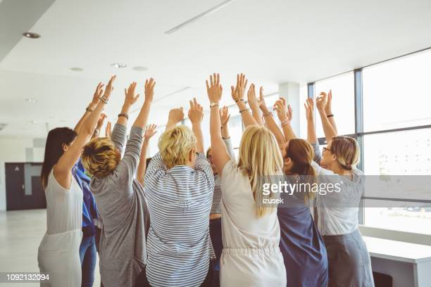 team building seminar for women - large group of people stock pictures, royalty-free photos & images