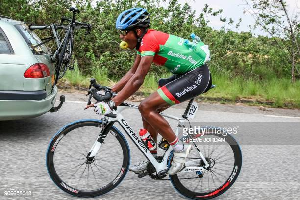 Team Burkina Faso rider Paul Daumont rides along the team car during a stage of the 2018 edition of La Tropicale Amissa cycling race on January 16...