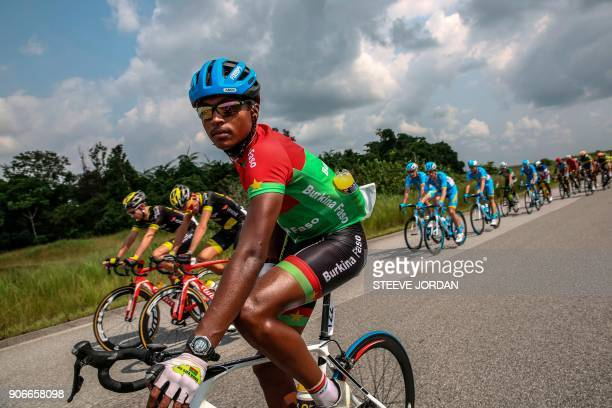 Team Burkina Faso rider Paul Daumont rides with the pack during a stage of the 2018 edition of La Tropicale Amissa cycling race on January 16 2018...