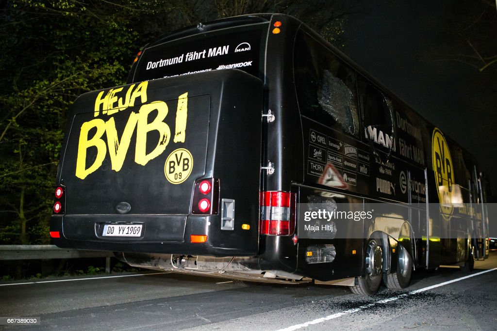 Team bus of the Borussia Dortmund football club damaged in an explosion is seen on April 12, 2017 in Dortmund, Germany. According to police an explosion detonated as the bus was leaving the hotel where the team was staying to bring them to their Champions League game against Monaco. So far one person, team member Marc Bartra, is reported injured.