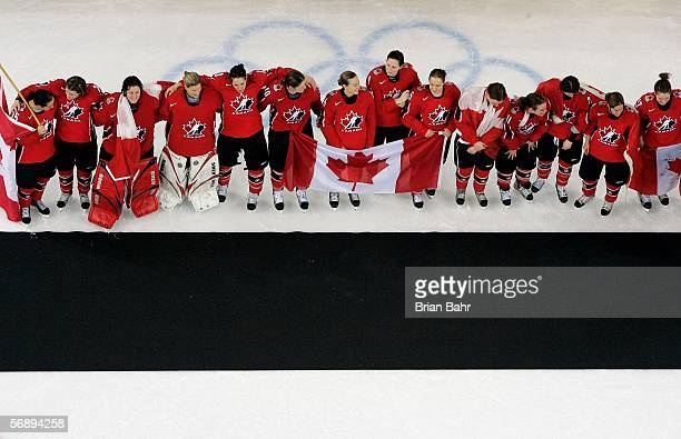 Team Canada awaits the presentation of the gold medal in women's ice hockey after defeating Sweden 4-1 during Day 10 of the Turin 2006 Winter Olympic...