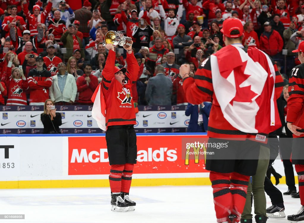 Team Canada captain Dillon Dube #9 of Canada skates with the trophy to his teammates after the Gold medal game against Sweden of the IIHF World Junior Championship at KeyBank Center on January 5, 2018 in Buffalo, New York. Canada beat Sweden 3-1.