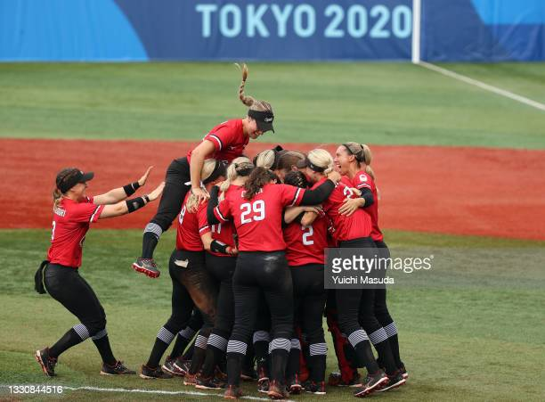 Team Canada celebrate after defeating Team Mexico 3-2 in the women's bronze medal softball game between Team Mexico and Team Canada on day four of...