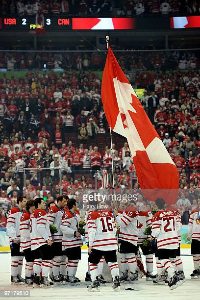 Team Canada celebrate after receiving their gold medals following their 32 overtime victory during the ice hockey men's gold medal game between USA...