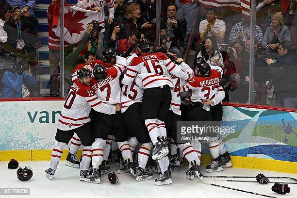 Team Canada celebrate after Sidney Crosby of Canada scores the matchwinning goal in overtime during the ice hockey men's gold medal game between USA...