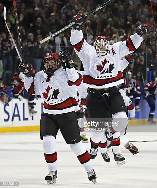 Team Canada celebrate following their 32 gold medal winning performance over the USA in the Women's Ice Hockey final of the XIX Winter Olympics 21...