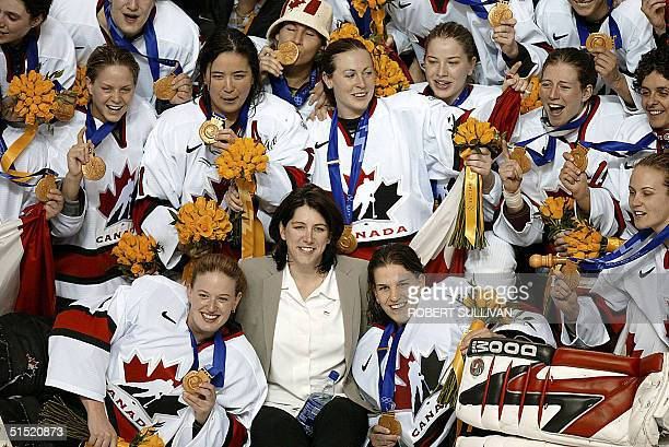 Team Canada celebrate their 3-2 gold medal winning performance over the USA in the Women's Ice Hockey final of the XIX Winter Olympics 21 February...