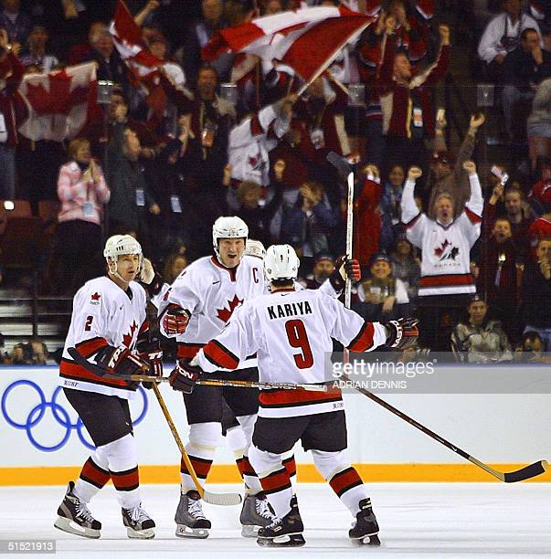 Team Canada celebrate their first period goal against the USA by teammate Paul Kariya during the Men's Ice Hockey gold medal final of the XIX Winter...
