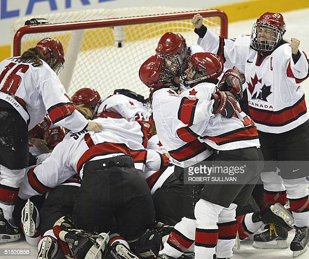Team Canada celebrate their gold medal winning performance against the USA in the Women's Ice Hockey final of the XIX Winter Olympics 21 February...