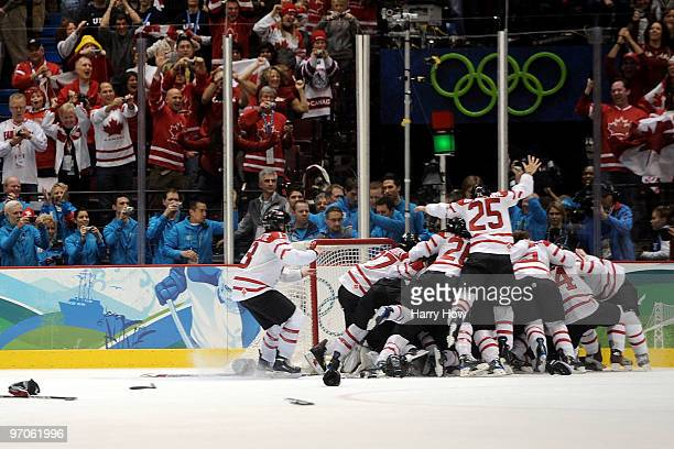Team Canada celebrate winning the gold medal following their 2-0 victory during the ice hockey women's gold medal game between Canada and USA on day...