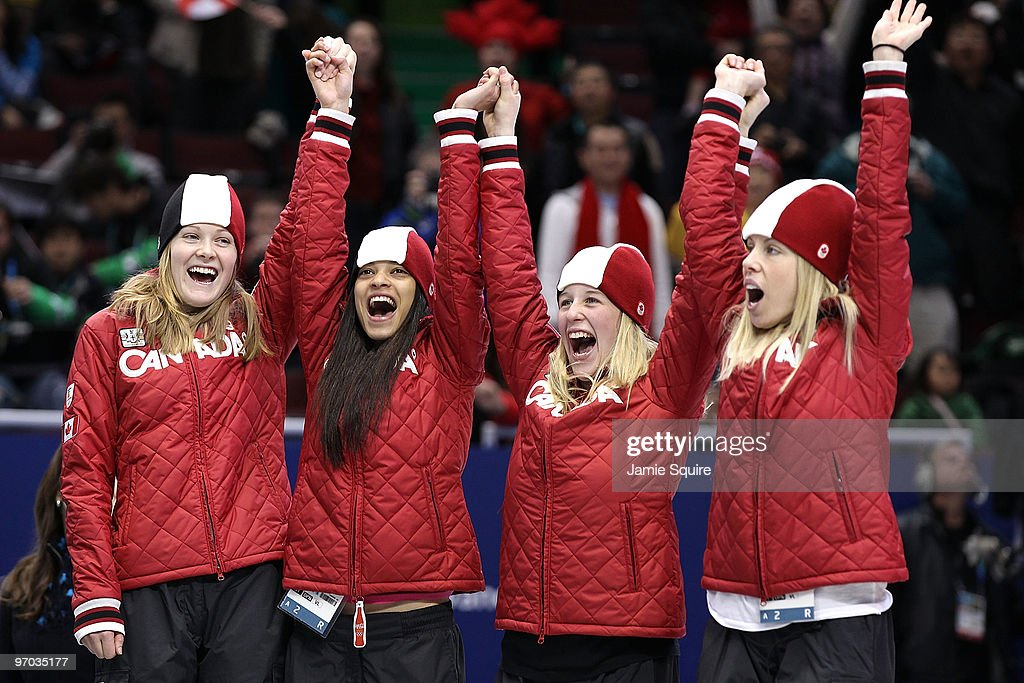 Team Canada celebrate winning the silver medal in the Short Track Speed Skating Ladies' 3000m relay finals on day 13 of the 2010 Vancouver Winter Olympics at Pacific Coliseum on February 24, 2010 in Vancouver, Canada.
