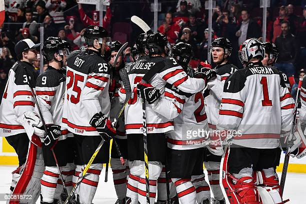 Team Canada celebrates a victory during the 2017 IIHF World Junior Championship quarterfinal game against Team Czech Republic at the Bell Centre on...