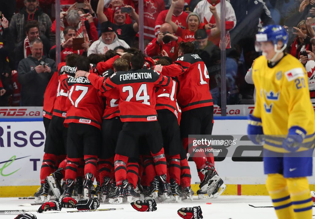 Team Canada celebrates after beating Sweden in the Gold medal game of the IIHF World Junior Championship at KeyBank Center on January 5, 2018 in Buffalo, New York. Canada beat Sweden 3-1.