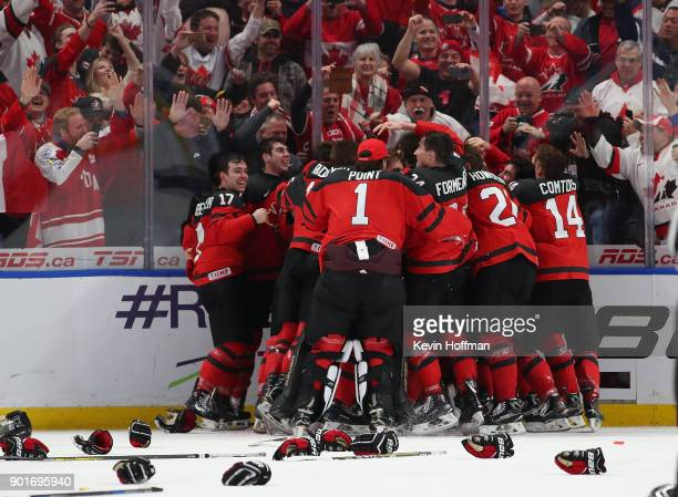 Team Canada celebrates after beating Sweden in the Gold medal game of the IIHF World Junior Championship at KeyBank Center on January 5 2018 in...