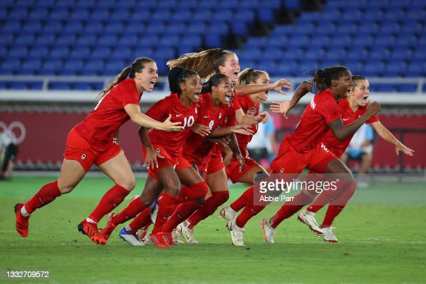 Team Canada celebrates after defeating Team Sweden in a penalty shoot-out to win gold in the women's football gold medal match between Canada and...