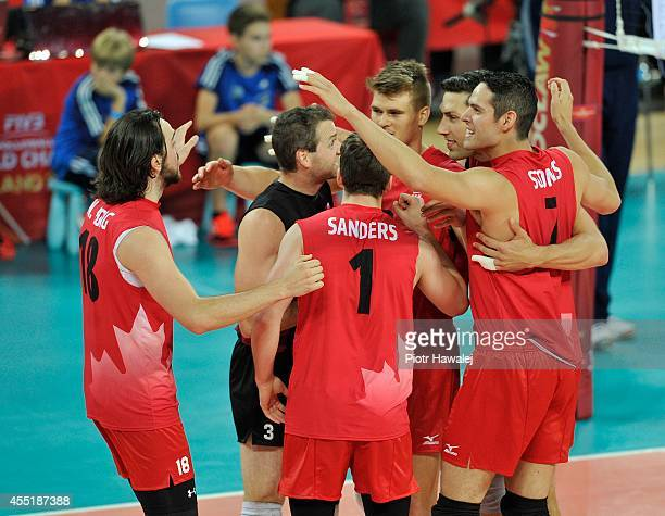 Team Canada celebrates after winning a point during the FIVB World Championships match between Cuba and Canada on September 10 2014 in Wroclaw Poland