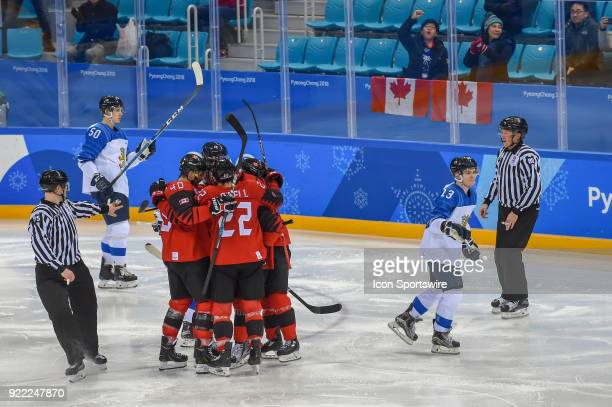 Team Canada celebrates an early third period goal by Canada men's hockey defender Maxim Noreau assisted by Canada men's hockey forward Eric O'Dell...