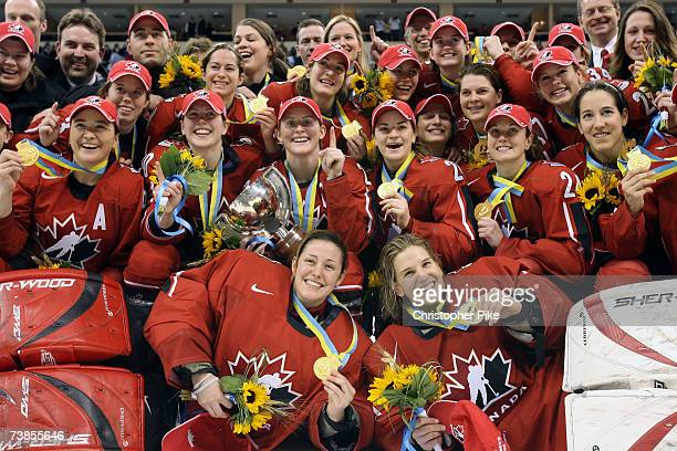 Team Canada celebrates defeating the USA 51 in the IIHF Women's World Championship Gold Medal game between Canada and the United States of America at...