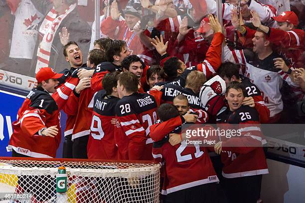 Team Canada celebrates the 54 win against Russia during the Gold medal game of the 2015 IIHF World Junior Championship on January 05 2015 at the Air...