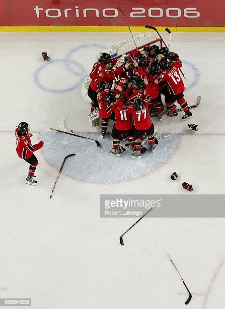 Team Canada celebrates their 4-1 victory over Sweden to win the gold medal in women's ice hockey during Day 10 of the Turin 2006 Winter Olympic Games...