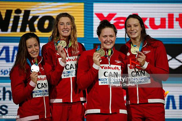 Team Canada celebrates their gold medal in the 4x200m Freestyle on day five of the 13th FINA World Swimming Championships at the WFCU Centre on...