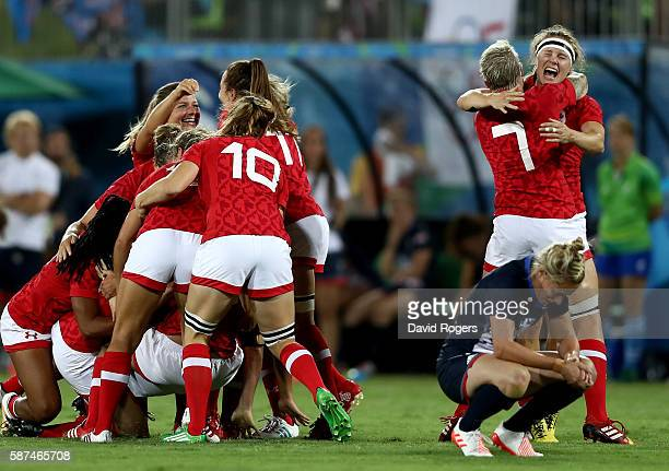 Team Canada celebrates their victory winning the Bronze medal after the Women's Bronze Medal Rugby Sevens match between Canada and Great Britain on...