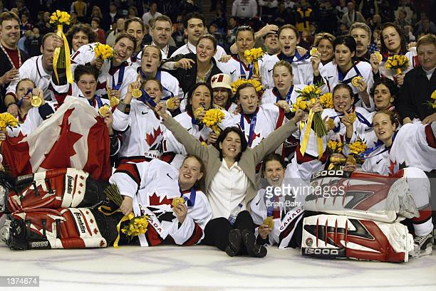 Team Canada celebrates winning the women's ice hockey gold medal game 3-2 over the USA at the Salt Lake City Winter Olympic at the E Center in Salt...