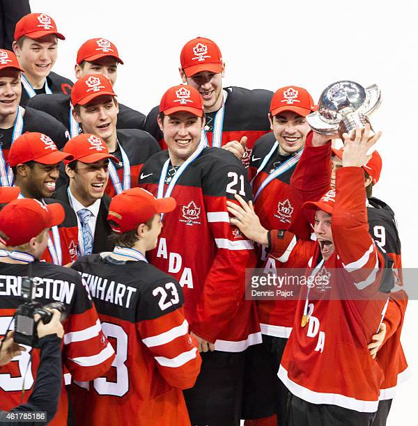 Team Canada celebrates with the trophy after a 54 win against Russia during the Gold medal game of the 2015 IIHF World Junior Championship on January...