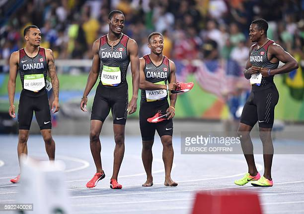 Team Canada de Canada's Andre De Grasse Canada's Brendon Rodney Canada's Akeem Haynes and Canada's Aaron Brown celebrate after finishing third of the...