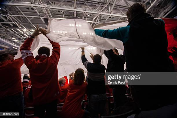 Team Canada fans move an enormous Maple Leaf flag during a game against Denmark during the 2015 IIHF World Junior Championship on January 02 2015 at...