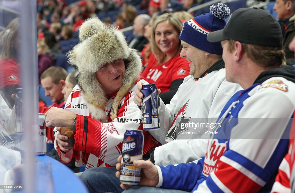 Team Canada fans share a laugh as team Canada defeated Switzerland 8-2 in the Quarterfinal IIHF World Junior Championship game at the KeyBank Center on January 2, 2018 in Buffalo, New York.